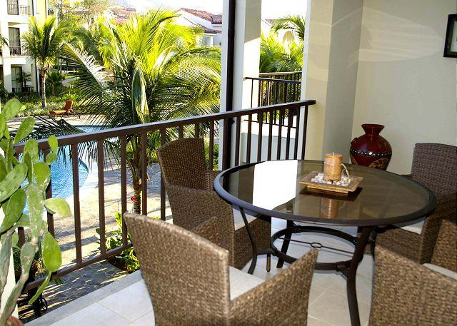 The Balcony is spacious and fully furnished. - Pacifico L210 - Charming Pacifico One Bedroom Condo Overlooking Pool - Playas del Coco - rentals