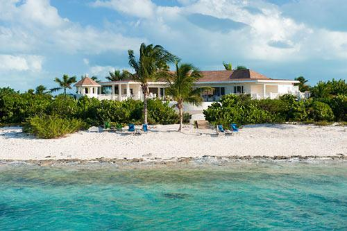 A photograph of Turtle Beach Villa and the beautiful, white, sandy beach. - Turtle Beach Villa--5 bedrooms on the beach! - Providenciales - rentals