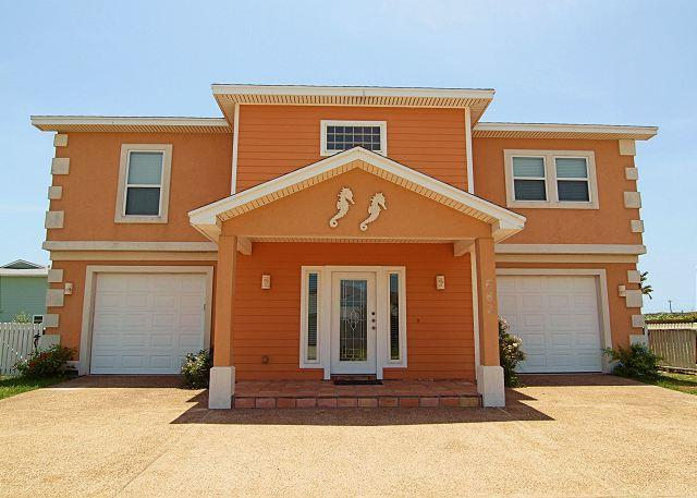 Welcome to the Orange Seahorse - 4 bedrooms, 3 baths, 2 car garage, sleeps 16 and offers wireless internet!! - Port Aransas - rentals