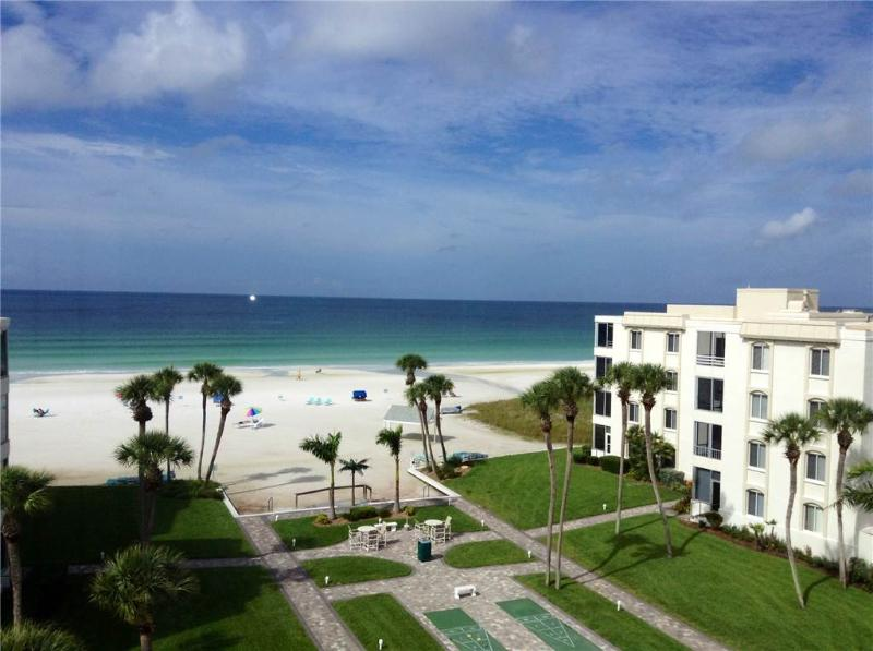 Palm trees, white sand, and the crystal blue waters - 17 South - Image 1 - Siesta Key - rentals