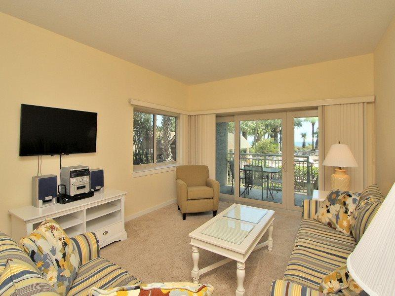 Living Room with Deck Access at 429 Captains Walk - 429 Captains Walk - Palmetto Dunes - rentals