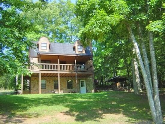 KINGDOM CABIN #1- 4BR/3BA- TOTALLY SECLUDED CABIN SLEEPS 8, PING PONG, POND, CHARCOAL GRILL, SAT TV, WIFI, WOOD BURNING FIREPLACE, PORCH SWING, PLAY AREA FOR CHILDREN! ONLY $99/NIGHT! - Image 1 - Blue Ridge - rentals