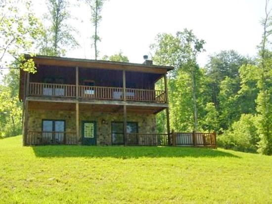 KINGDOM CABIN #2- 3BR/2BA- TOTALLY SECLUDED CABIN WITH CREEK SLEEPS 8, HOT TUB, CHARCOAL GRILL, FIREPLACE, FIRE PIT, AND PET FRIENDLY! ONLY $99/NIGHT! - Image 1 - Blue Ridge - rentals