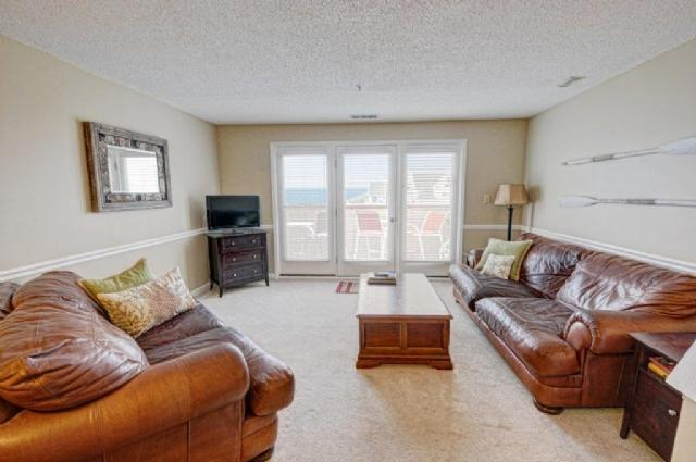 Living Room - Villa Capriani 319-A Oceanfront | 3 Pools, Largest Pool on NC Coast, 2 Hot Tubs, Grill Area, Tennis Courts, Restaurant, Internet - North Topsail Beach - rentals