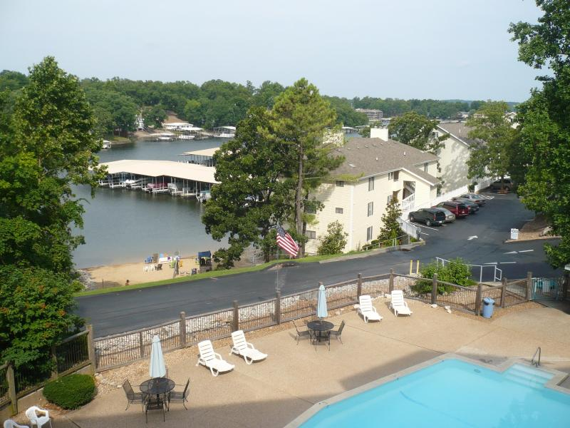 View from our balcony; pool, beach, and cove - Spacious Ledges 3 BR Condo - No Steps !! - Osage Beach - rentals