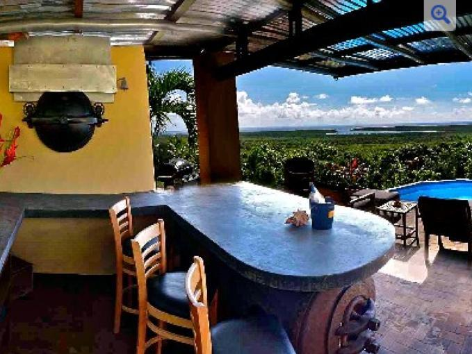 View from the pool bar overlooking the Caribbean Sea! - Private Pool Bar with Panoramic Caribbean View! - Isla de Vieques - rentals