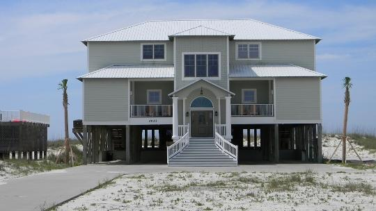 """Front of home, large concrete driveway with plenty of parking. - """"Crews Quarters"""" Luxury Gulf Front Home w/pvt pool - Gulf Shores - rentals"""
