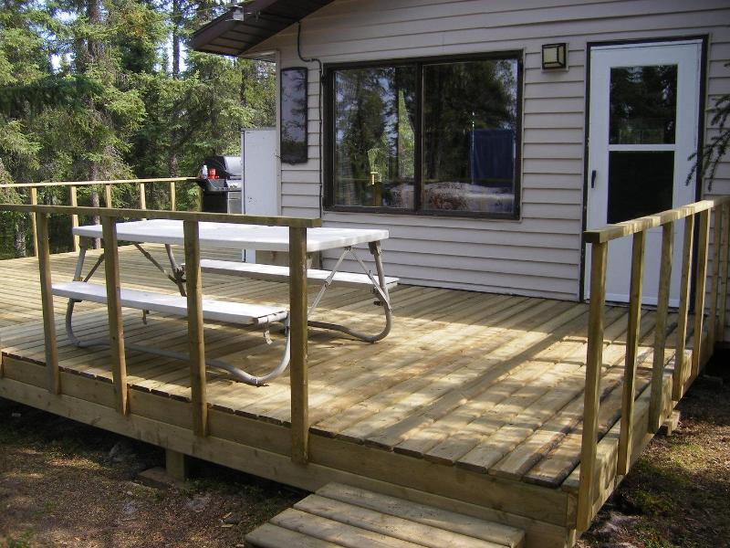 Deck with a view of the lake - Wheeler River Lodge - Saskatchewan Fly-in Fishing - La Ronge - rentals