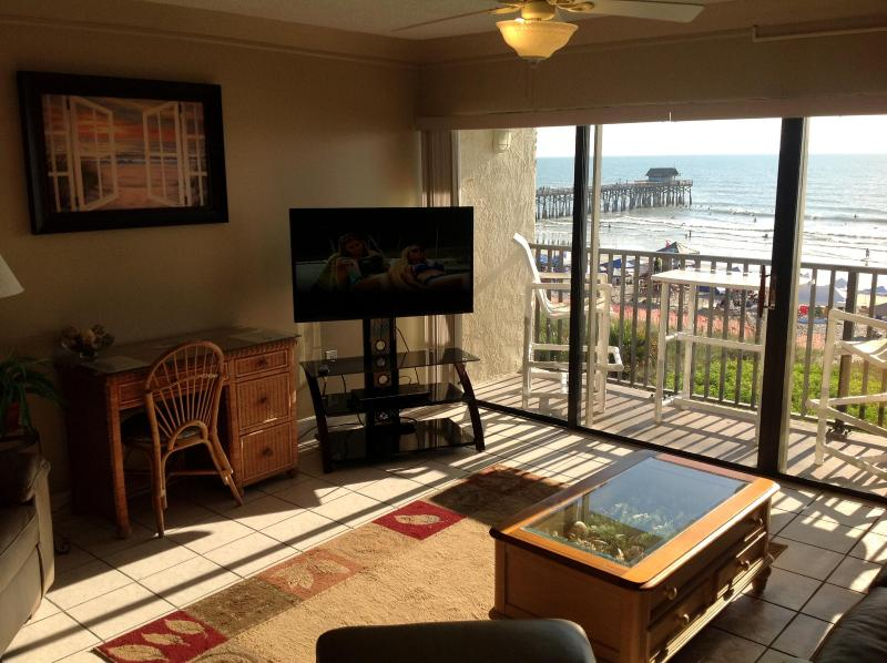 Living Room View of Pier and new Plasma TV - Penthouse- Next to Pier - Fully Renovated - Cocoa Beach - rentals