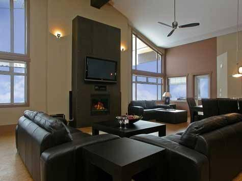Huge lounge area with lots of comfy leather sofa seating around the fire and large screen plasma TV for watching DVDs. Stunning mountain views and privacy from this elevated Penthouse level - The Raven - Penthouse 1491 - Big White - rentals