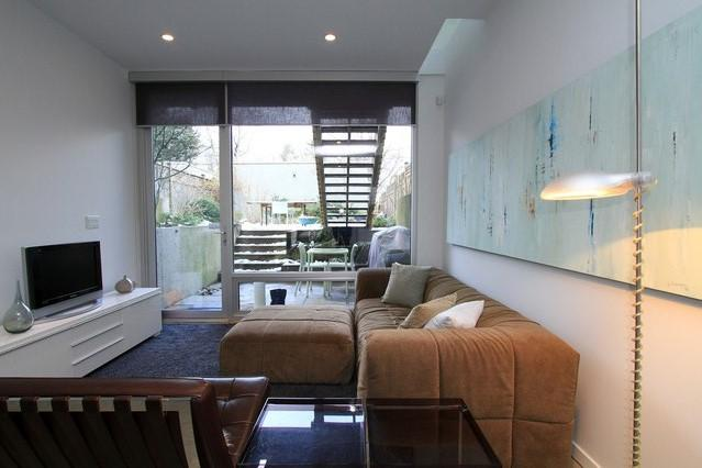 Bright living room with floor to ceiling windows and skylights running accross the room. - Stunning, Contemporary Vancouver Garden Suite - Vancouver - rentals