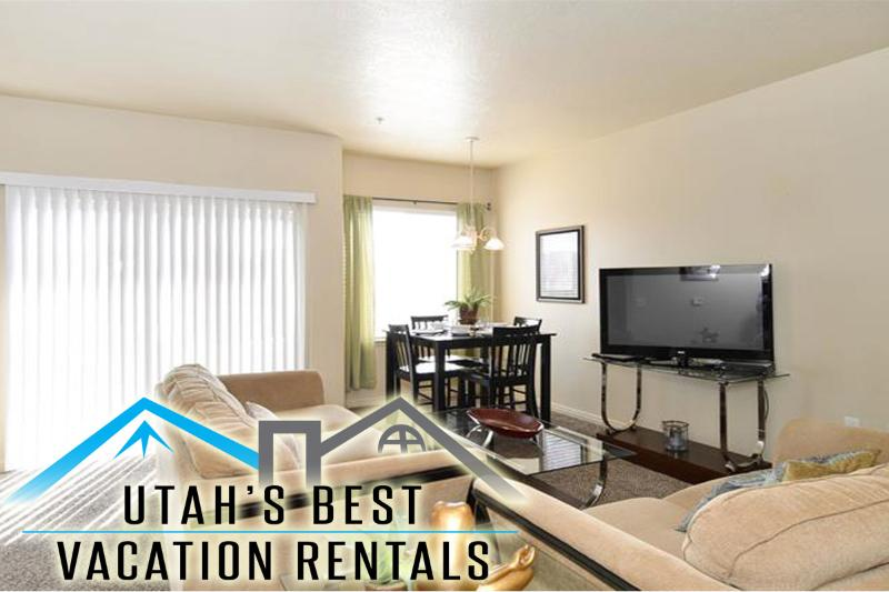 Family room with sofas, patio, dining table - Central Sandy Condo Near Skiing and Dwntwn - Call! - Salt Lake City - rentals