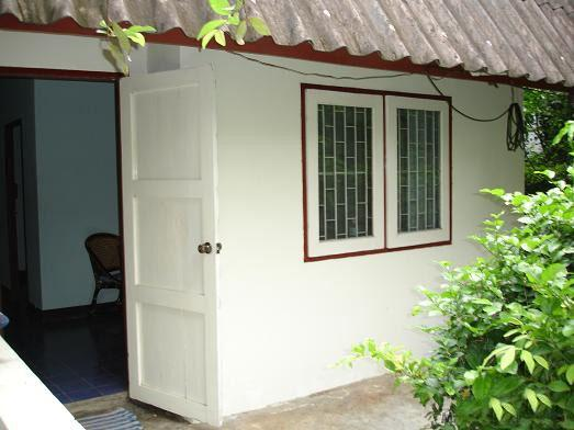 Here is the front door.  You can see into the living room - Ground level garden apartment - Ratchaburi - rentals
