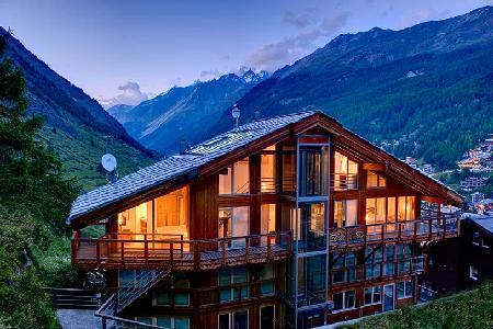 Architect-designed chalet Heinz Julen Penthouse with glass ceilings, hot tub & mountain views - Image 1 - Zermatt - rentals
