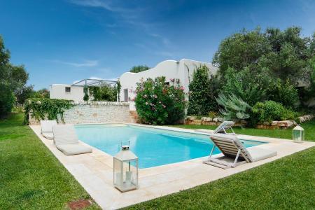 Rustic Puglian trullo, Trulli Di Nani in olive grove with lush garden & pool - Image 1 - Cisternino - rentals