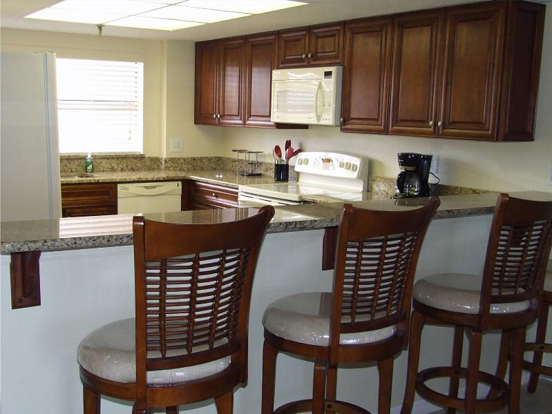 Kitchen - Custom Made Cabinet and Granite Counter Tops - Stylish Southwind 1st fl Oceanfront Renovated 2013 - New Smyrna Beach - rentals