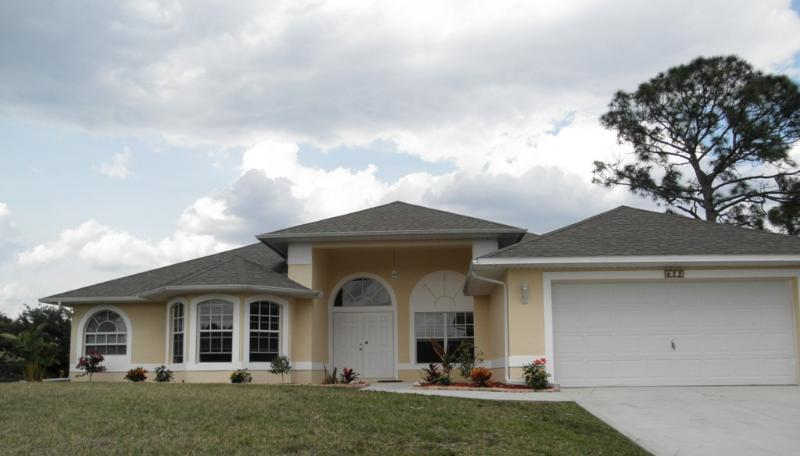 Front Facade - LUXURY SOUTHWEST FLORIDA GOLF COURSE HOME! - Lehigh Acres - rentals