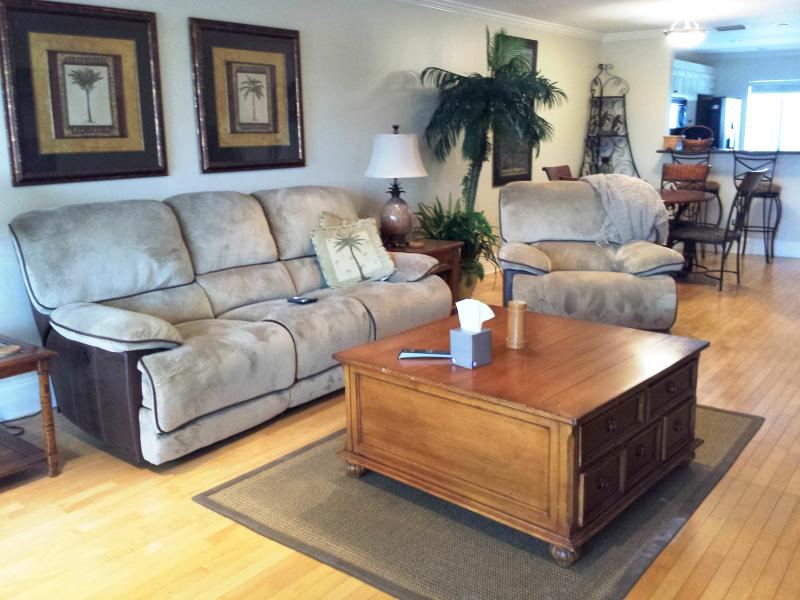 Family room area.  reclining couch is fully electric.  Wall hugger. - Siesta Key condo on the bay with gulf view - Siesta Key - rentals