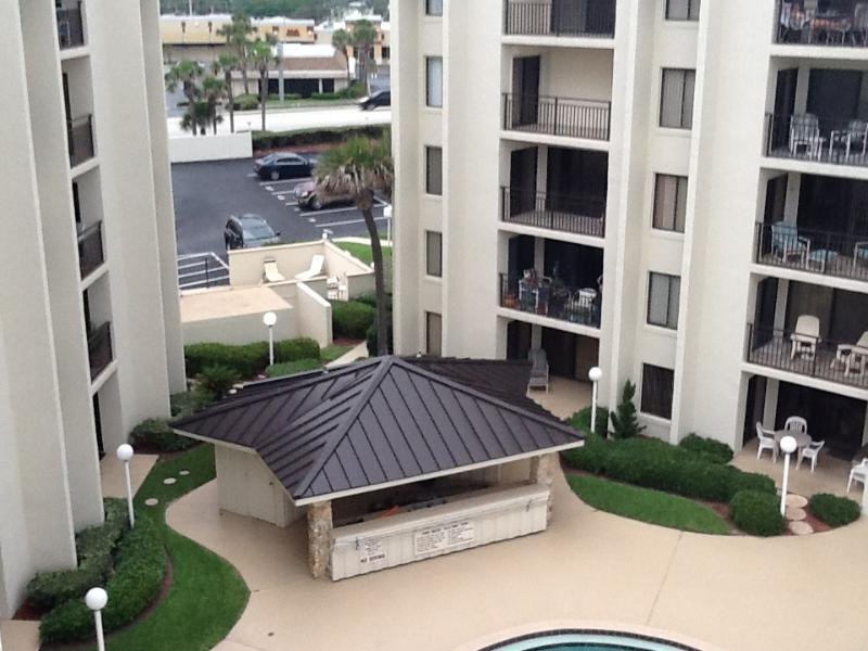 Cabana behind it are table, chairs and barbecue - Ormond Beach Condo, Ormond ByThe Sea - Ormond Beach - rentals
