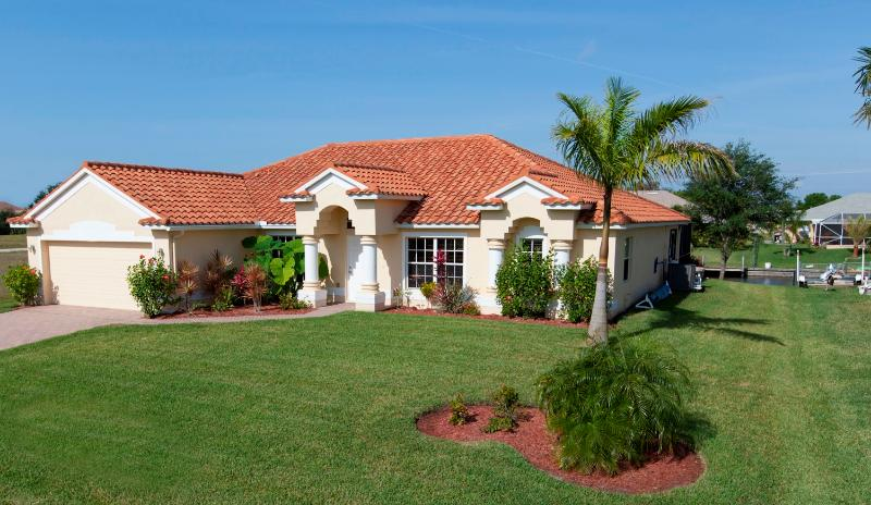 Front of Villa (Gulf of Mexico access on salt water canal) - Sunsets from the Lanai.  Luxury Villa with Heated - Cape Coral - rentals