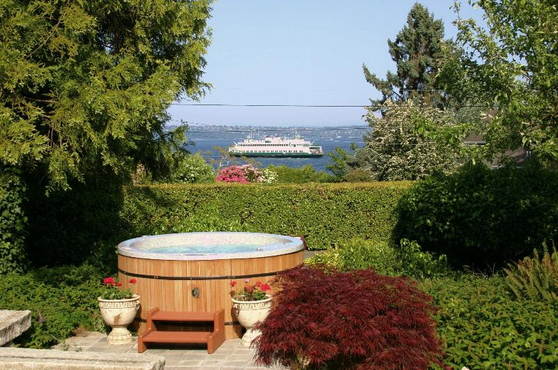 View of the ferry pulling in from the hot tub in the gardens. - Bryn Hyfryd- Historic Welsh / Hot Tub & Sea Views! - Port Orchard - rentals