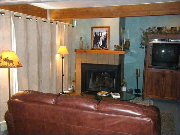Sleeper Sofa, Wood-Burning Fireplace, and a TV in the Living Room - Inviting Mountain Edge Condo - Easy Access to Downtown (1308) - Crested Butte - rentals