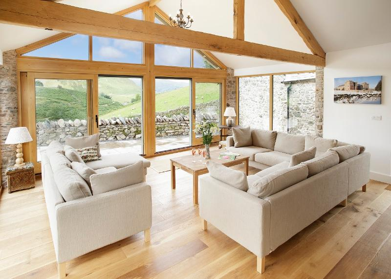 The Day Room at Hause Hall Farmhouse overlooking the fells and opening onto the stone terrace - Hause Hall & the Cruik Barn, Lake District Park - Penrith - rentals