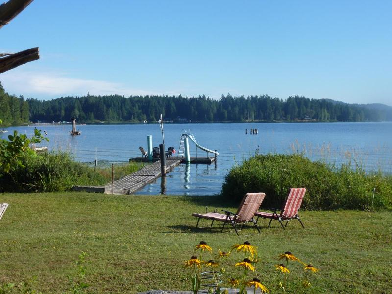 A sunny morning at the lake. This is our front yard where you can hang out or swim off the dock. - Shawnigan Lake Cottage Suite - Shawnigan Lake - rentals