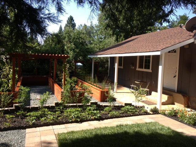 Cottage patio is facing our raised bed dwarf fruit tree garden - Butler Cottage-A Modern In-Town Experience - Grass Valley - rentals