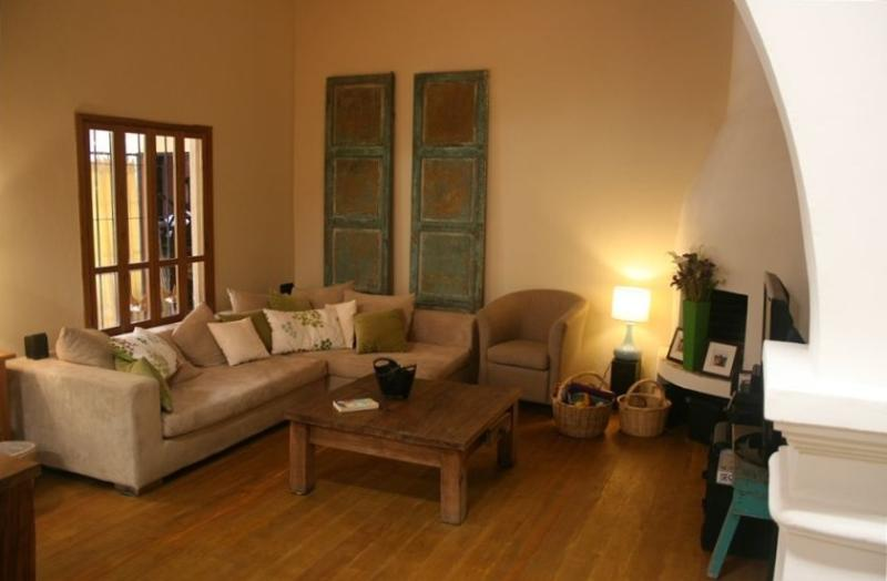 Livingroom area with TV, DVD and large selection  of movies and wireless ineternet - Spacious, Stylish 2 Bedroom Home in Central Antigua - Antigua Guatemala - rentals