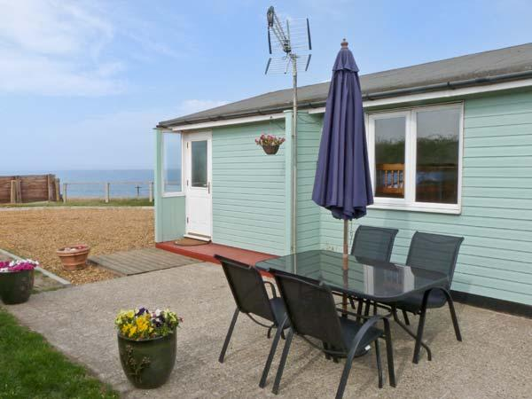 SEACLOSE detached beach front cottage, pet-friendly, sea views in Walcott Ref 26250 - Image 1 - Walcott - rentals