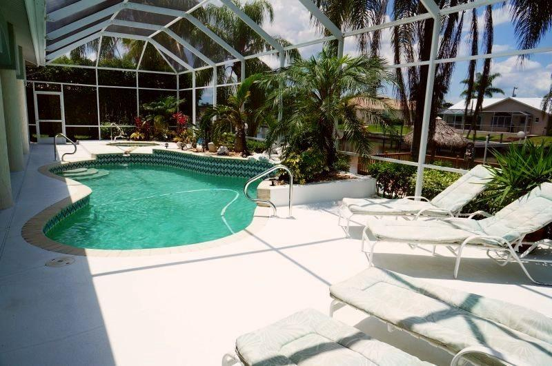 Villa Charlene - Cape Coral 3b/2ba deluxe home w/electric heated pool/spa, gulf access canal, HSW Internet, Boat Dock w/Lift (7000 lb) + Tiki Hut - Image 1 - Cape Coral - rentals
