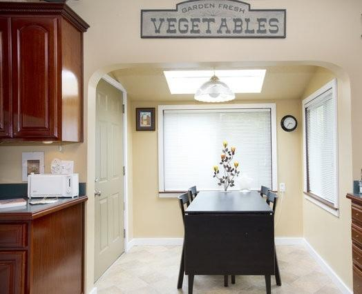 Breakfast nook with skylight, off kitchen - Elegant Sellwood Old Portland Home with Hot Tub - Portland - rentals