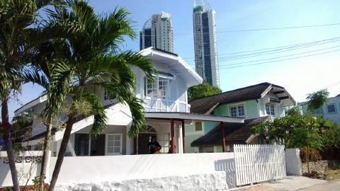 white villa, background view of other neighbors