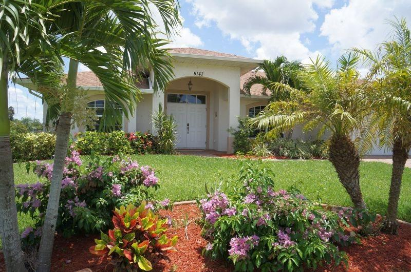 Villa Emily - Cape Coral 3b/2ba home w/electric heated pool/spa, located in The Cape Yacht Club Area, on gulf access canal, HSW Internet, Boat Dock w/Tiki Hut - Image 1 - Cape Coral - rentals