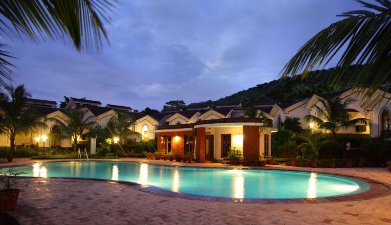 Evening view of pool area - serene & romantic ! - Surya Suites at Riviera Foothills - Arpora - rentals