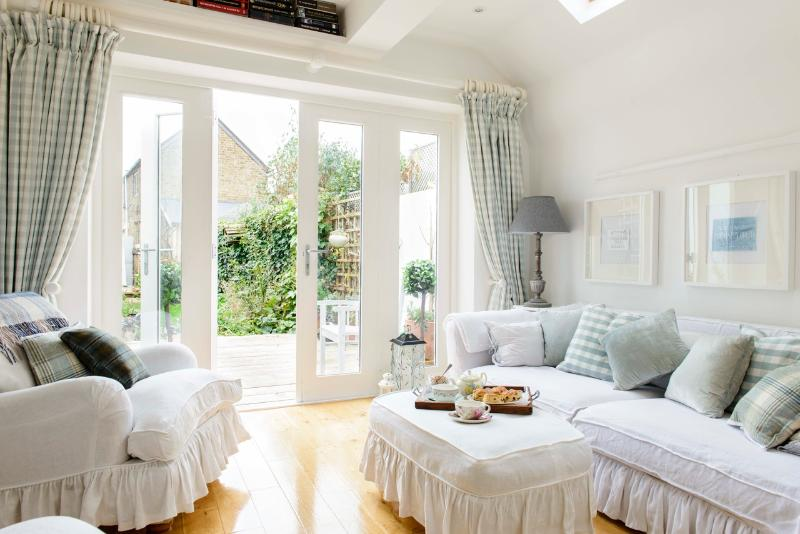 The sitting room and garden - Whitstable Island glorious cottage yards fro beach - Whitstable - rentals