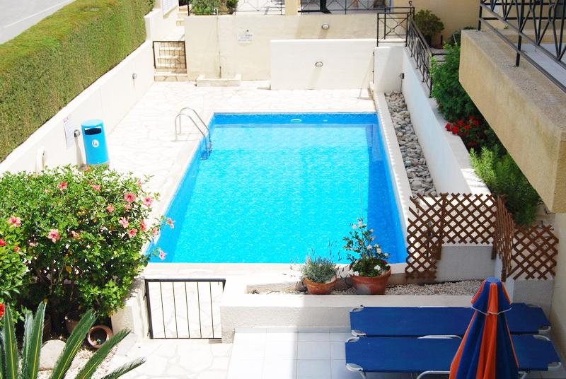 View from balcony on swimming pool - Coral Bay 2 bedroom town house - Paphos - rentals
