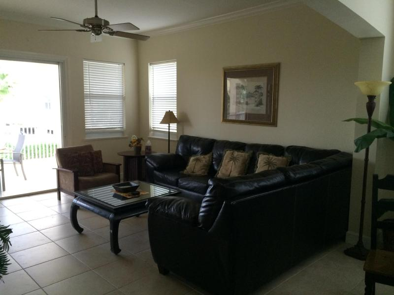 Living Room with New Leather Sofa - Luxury Beach Condo- Cinnamon Beach 325 Palm Coast - Palm Coast - rentals