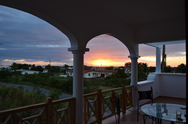 sunset view from balcony - New condo with large balcony - Oistins - rentals