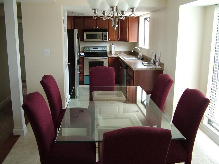 Large Dining Area w/ Glass Table - Luxury Condo Large & Clean 4 Seasons Country Club - Lake Ozark - rentals