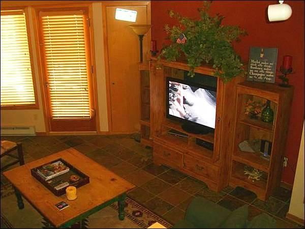 Living Room Includes a Flat-Screen TV and Opens to a Private Balcony - Charming Vacation Condo - Spacious Yet Cozy (1291) - Crested Butte - rentals