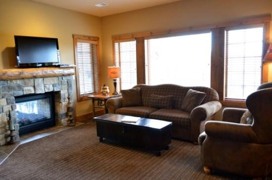 Spacious Livign Room with Queen Sofa Sleeper, Flat Screen TV, Fireplace, and Wall of Windows. - 2BR Creekside Condo at Boyne Mountain - Ski In/Ski Out in Boyne`s Newest and Most Luxurious Condo Community - Boyne Falls - rentals