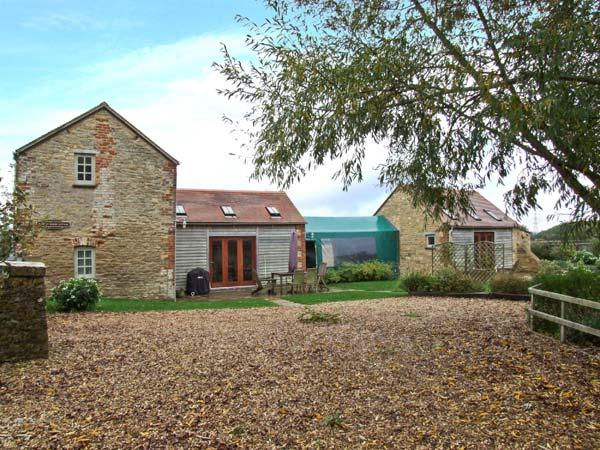 TADPOLE BRIDGE COTTAGE, pets welcome, WiFi, riverside location, en-suite facilities, near Bampton, Ref. 29653 - Image 1 - Bampton - rentals