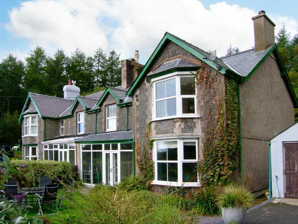 PENDYFFRYN, semi-detached cottage, two woodburners, parking, acre of woodland and wildflower garden, in Beddgelert, Ref 23711 - Image 1 - Beddgelert - rentals