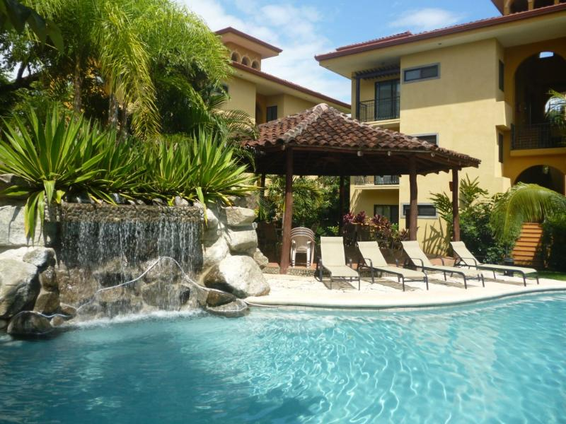 Our condo is steps from this beautiful pool and BBQ Ranchos area with plenty of loungers - Affordable Retreat in Paradise - Villarreal - rentals