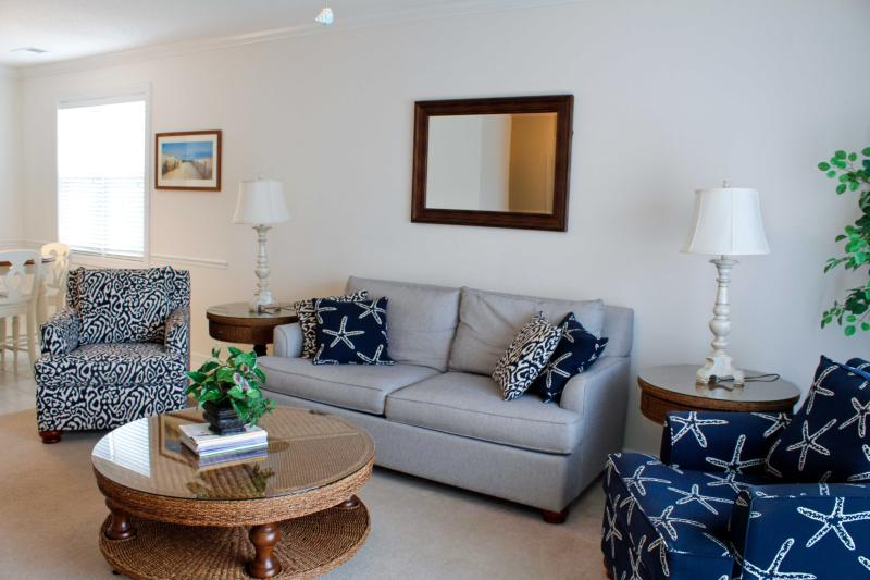 Warm and Inviting Living Room with Queen Dream Sleeper - Warm and Welcoming Golf Villa in Barefoot Resort overlooking the Greg Norman Golf Course - North Myrtle Beach - rentals