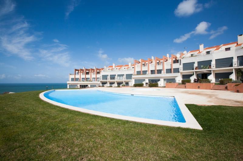 1199014 - Modern townhouse with stunning Sea Views, Pool and Tennis Court - Praia da Areia Branca - Image 1 - Leiria District - rentals