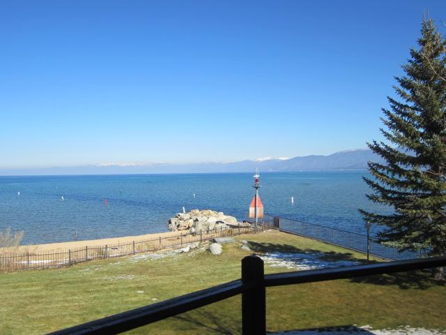 View of the back yard lawn, beach and Lake - Lighthouse Shores Beach House directly on Lake - South Lake Tahoe - rentals