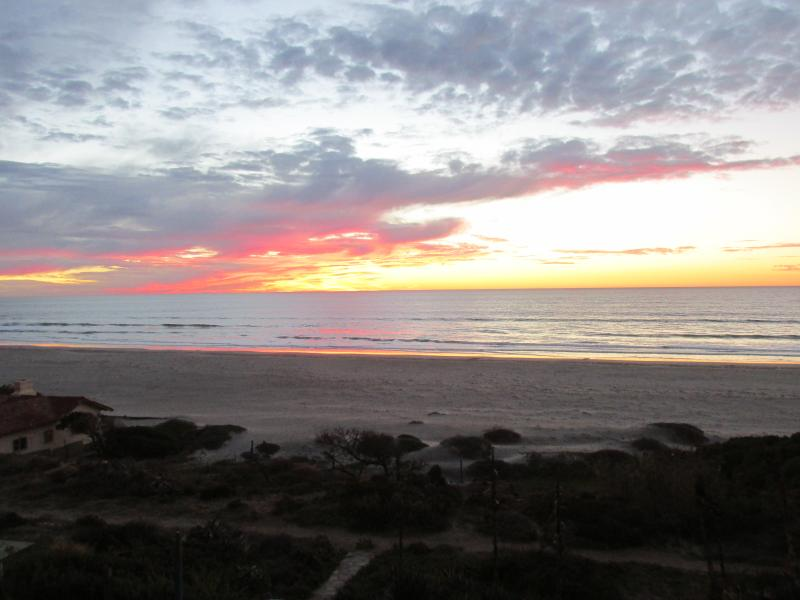 View from the two bedrooms, Living room/dining area - A HOLIDAY PARADISE – Beach, NFL Football, & Wine - La Mision - rentals